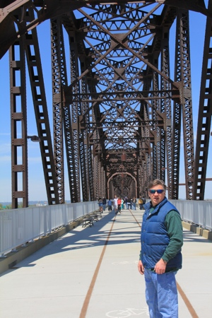 Diane shoots Mike on the Bridge.  Yes, headlines can be misleading. Picture by Diane Stevens in spring of 2013.